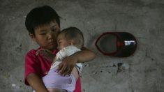 Registro de residência chinês deixa milhões de crianças órfãs