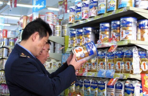 Regime chinês 'condecora' responsáveis por contaminação de leite em pó