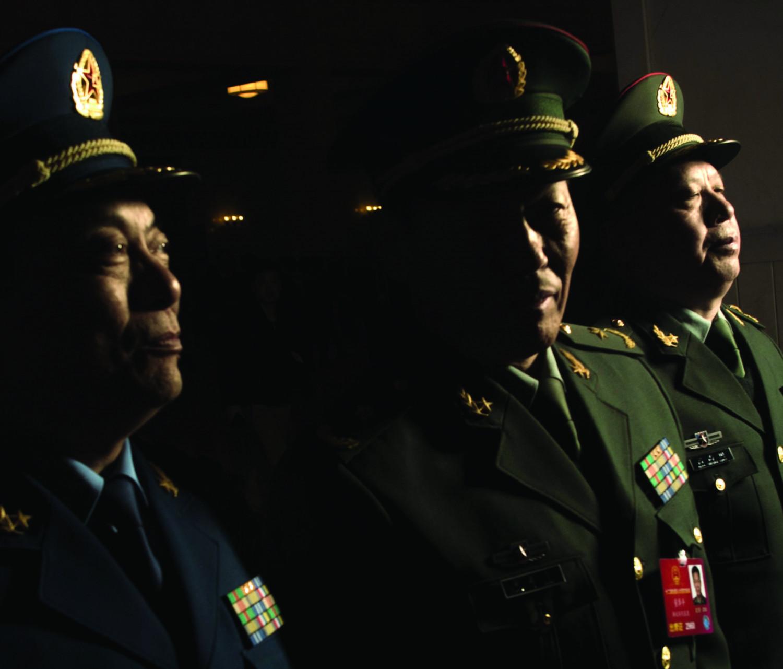 Delegados militares partem após a 2ª sessão plenária do Congresso Popular Nacional em Pequim em 9 de março de 2016 (Fred Dufour/AFP/Getty Images)
