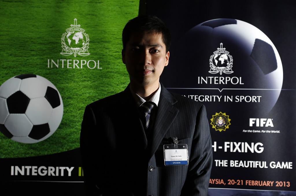 Danny Du Nan, ministro da segurança pública na China e palestrante sobre uma investigação de manipulação de resultados esportivos, durante uma conferência da Interpol num hotel em Kuala Lumpur, Malásia, em 20 de fevereiro de 2013 (Stanley Chou/Getty Images)
