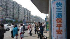 Praticantes na China comemoram Dia Mundial do Falun Dafa com faixas e cartazes