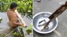 Rapazes mostram armadilha de pesca simples mas altamente eficaz, feita de vermes e bambu