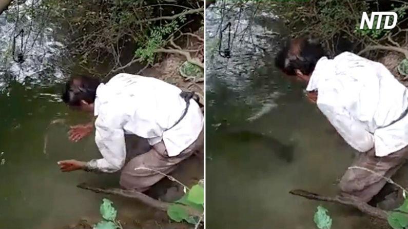 Homem começa a gritar na beira de um rio  – mas o que aparece em seguida é surpreendente