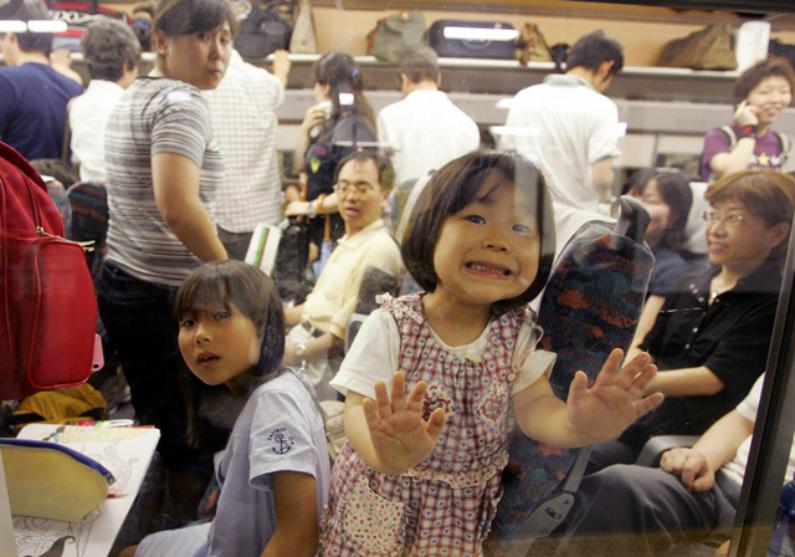 Passageiros de metrô no Japão (Kazuhiro Nogi/AFP/Getty Images)