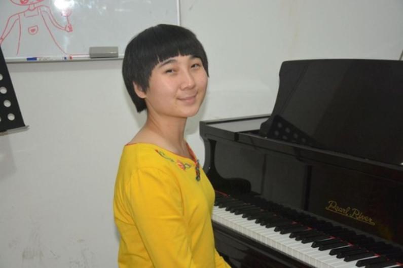 Shan, professora de piano (Minghui.org)