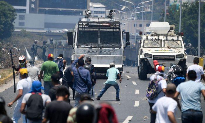 Supressão violenta da Venezuela contra os manifestantes é apoiada por suprimentos militares chineses