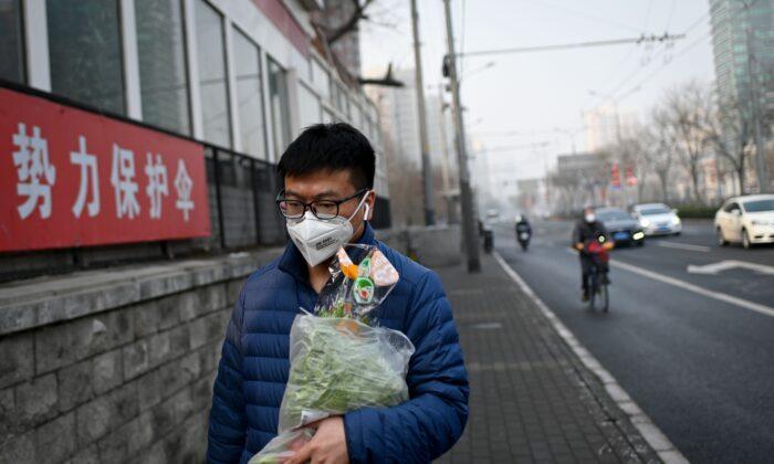 Pequim e outras regiões chinesas declaram 'estado de guerra' contra surto de coronavírus
