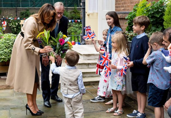 First Lady Melania Trump (L) and Philip May (R), husband of Britain's Prime Minister Theresa May, attend a garden party