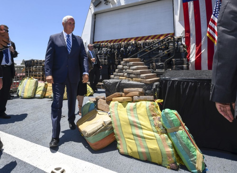 Pence stands beside seized drugs