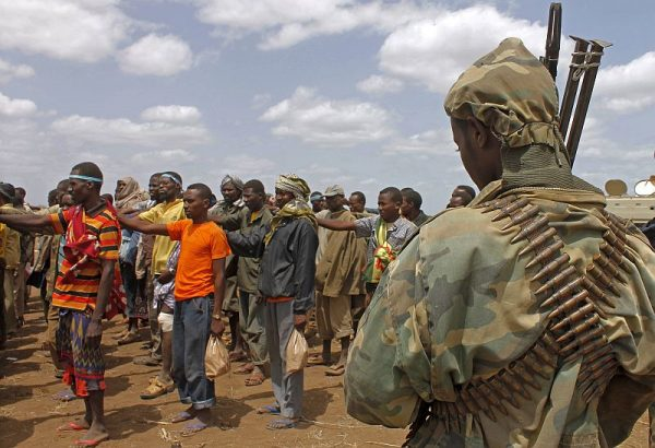 Members of the Al-Qaeda-linked Shebab standing after giving themselves up to forces of the African Union Mission in Somalia (AMISOM) in Garsale, north of the capital, Mogadishu, on Sept. 22, 2012. (Mohamed Abdiwahab/AFP/GettyImages)