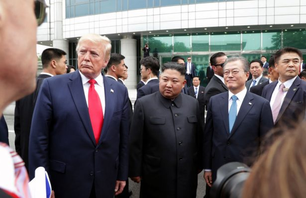 North Korean leader Kim Jong Un, U.S. President Donald Trump, and South Korean President Moon Jae-in inside the demilitarized zone