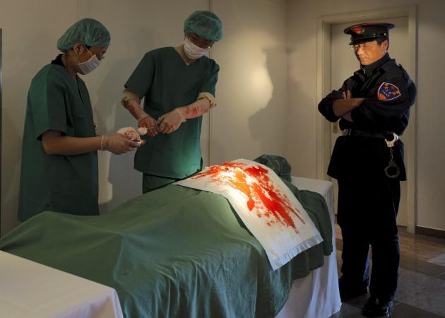 Recriação do ato de remoção de órgãos na China (Robert Michael / AFP / Getty Images)