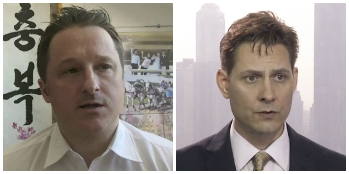 Canadians Michael Spavor (L) and Michael Kovrig