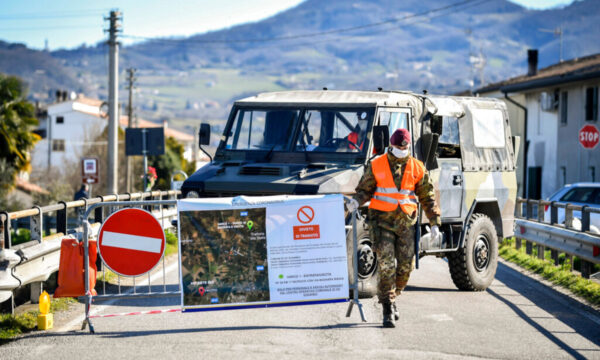 An Italian army soldier blocks off a road in Italy