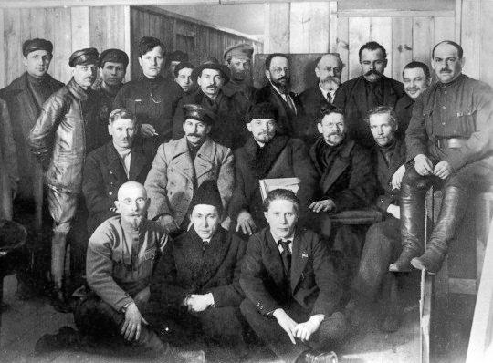 In the second row, starting from second left, are pictured Joseph Stalin, Vladimir Lenin, and Leon Trotsky as they gather for a meeting of the 8th Congress of the Bolshevik (later Soviet Communist) Party. (Public Domain)